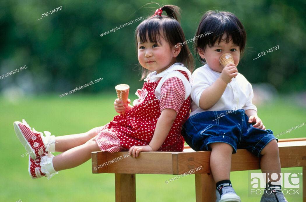 Stock Photo: Asian children eating ice-cream.