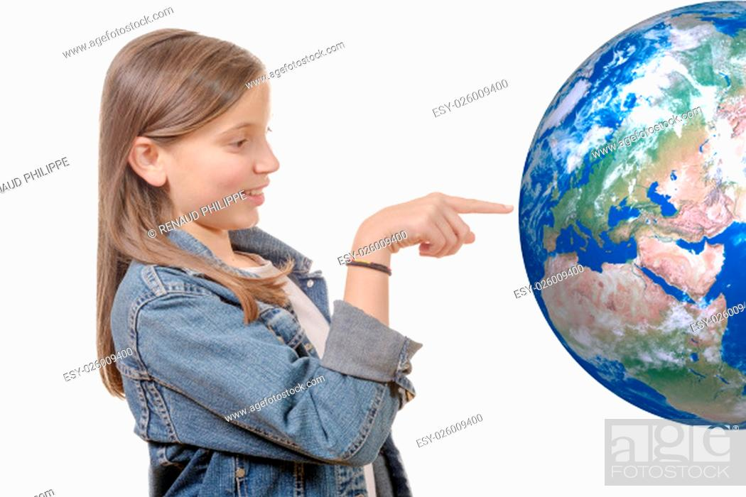 Stock Photo: Portrait of a smiling little girl pointing finger on world globe isolated on white background.
