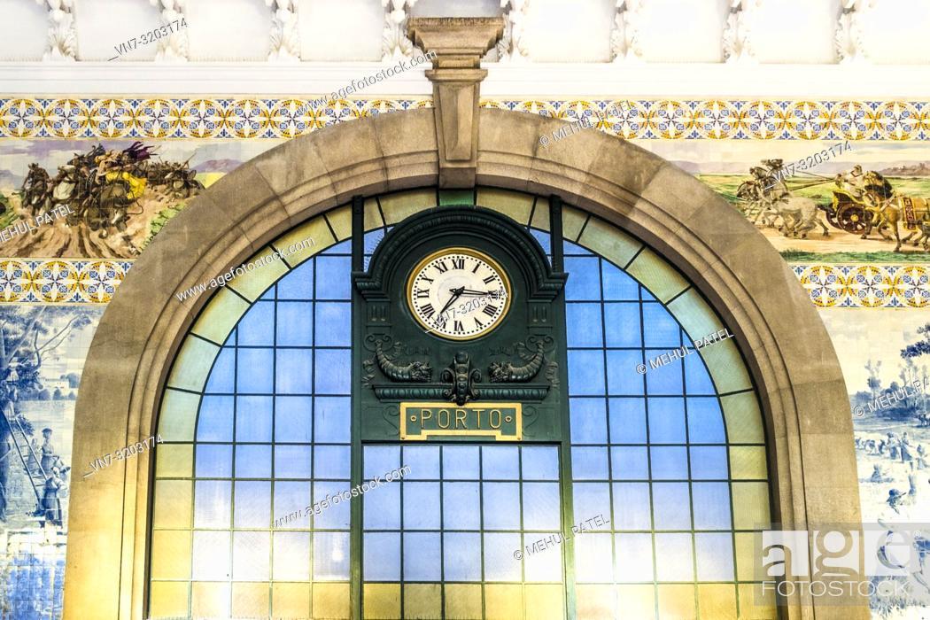 Stock Photo: Colourful wall tiles and main clock Inside São Bento train station (Estação São Bento) - Porto, Portugal.