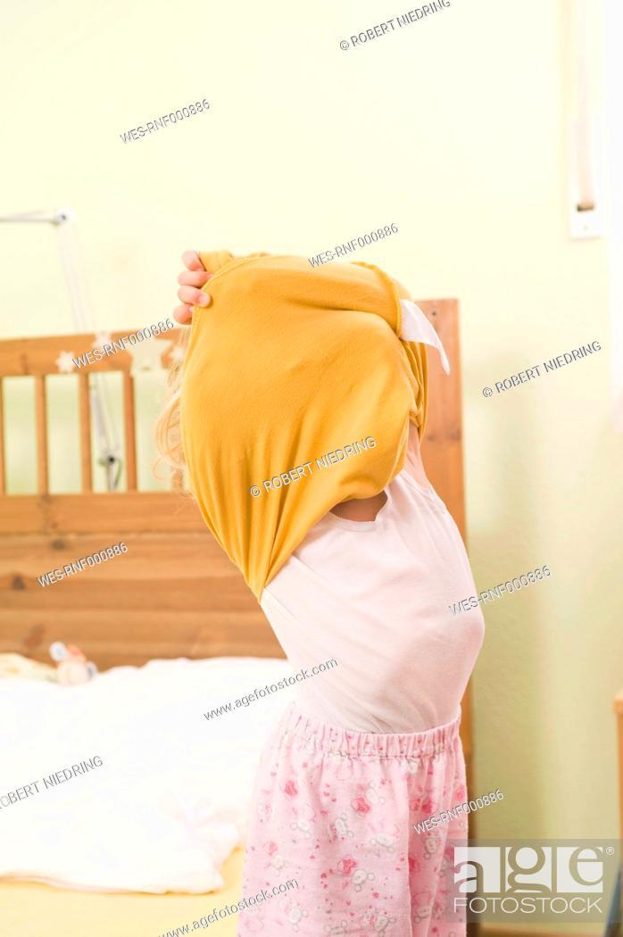 Stock Photo: Girl undressing.