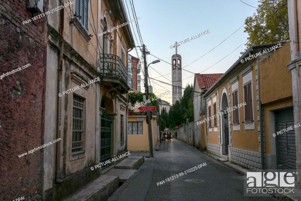Stock Photo: 26 October 2018, Albania, Shkodra: View into a narrow street, in the background the Franciscan church. Photo: Peter Endig/dpa-Zentralbild/ZB.