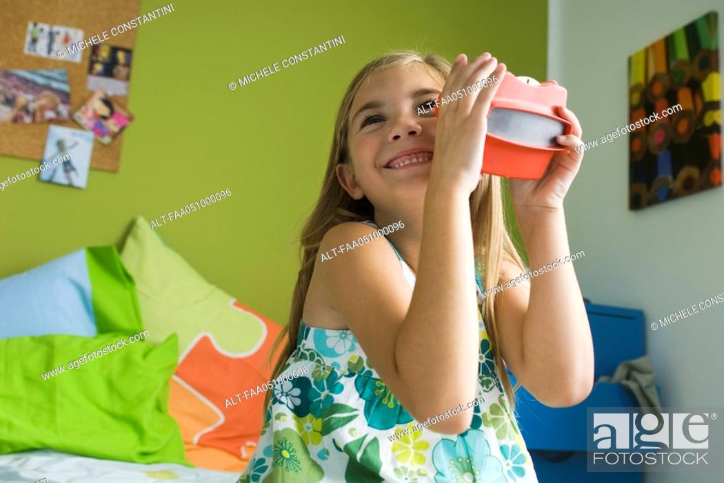 Stock Photo: Girl playing with toy viewfinder.