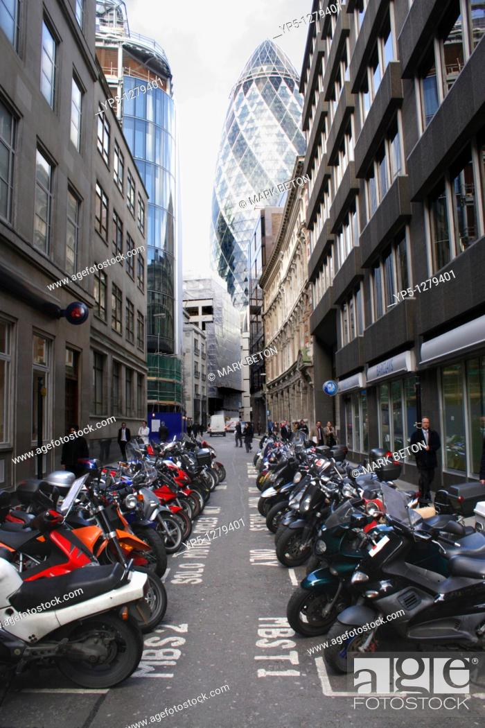 Stock Photo: Swiss Re Tower and parked motorbikes London.