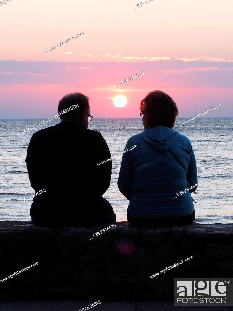 Stock Photo: Couple at sunset in Sunset Park Fish Creek Door County Wisconsin.