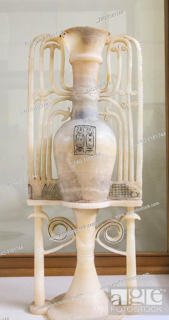Stock Photo: Egypt, Cairo, Egyptian Museum, Tutankhamon alabaster, from his tomb in Luxor : Unguent vase upon ornamental stand. With cartouches of Tutankhamun.