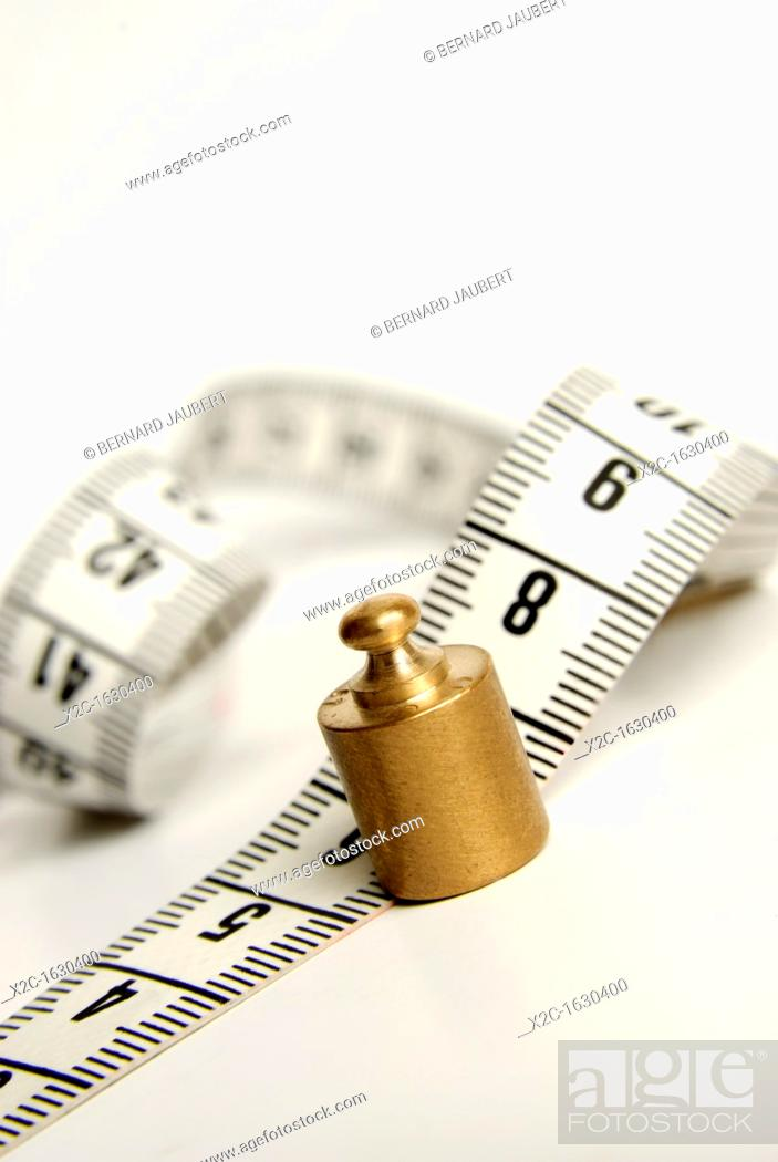 Stock Photo: Tape measure, scale weight, symbolic image weight cuts.