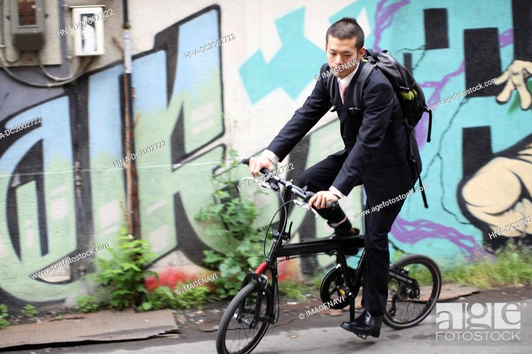 Stock Photo: Businessman on Bicycle.