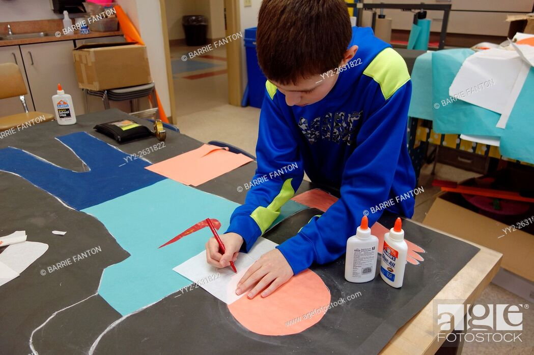 Stock Photo: 6th Grade Boy Working on Art Project, Wellsville, New York.
