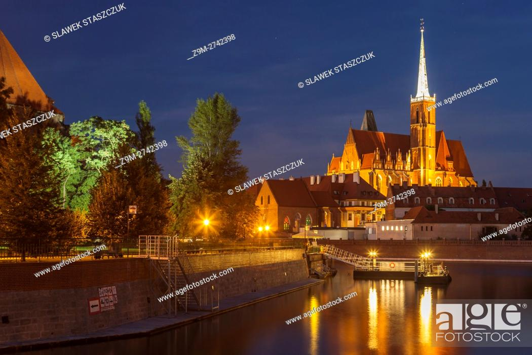 Stock Photo: Night falls at Ostrow Tumski in Wroclaw, Poland.