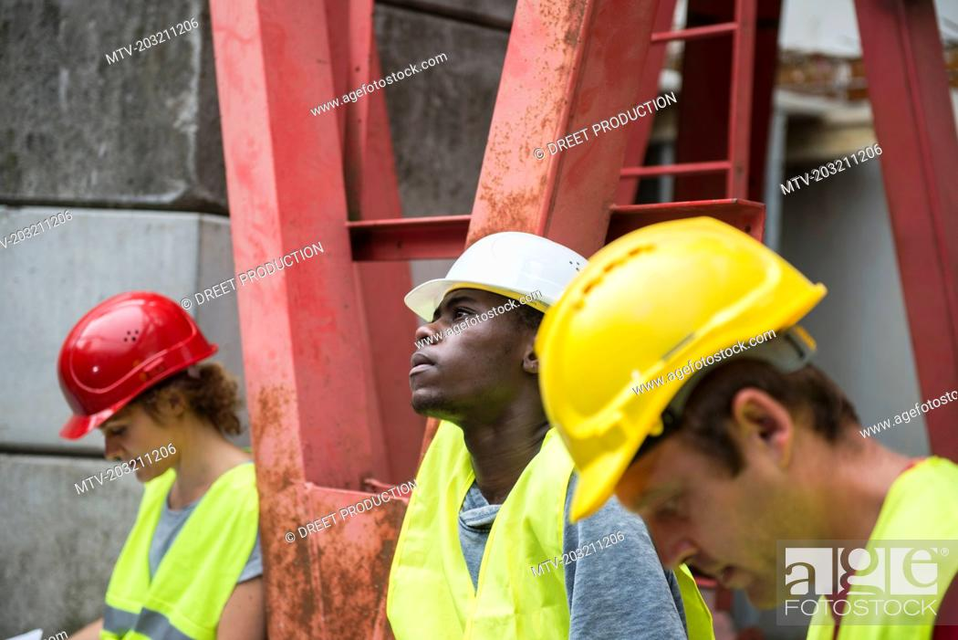 Stock Photo: Construction workers at building site.