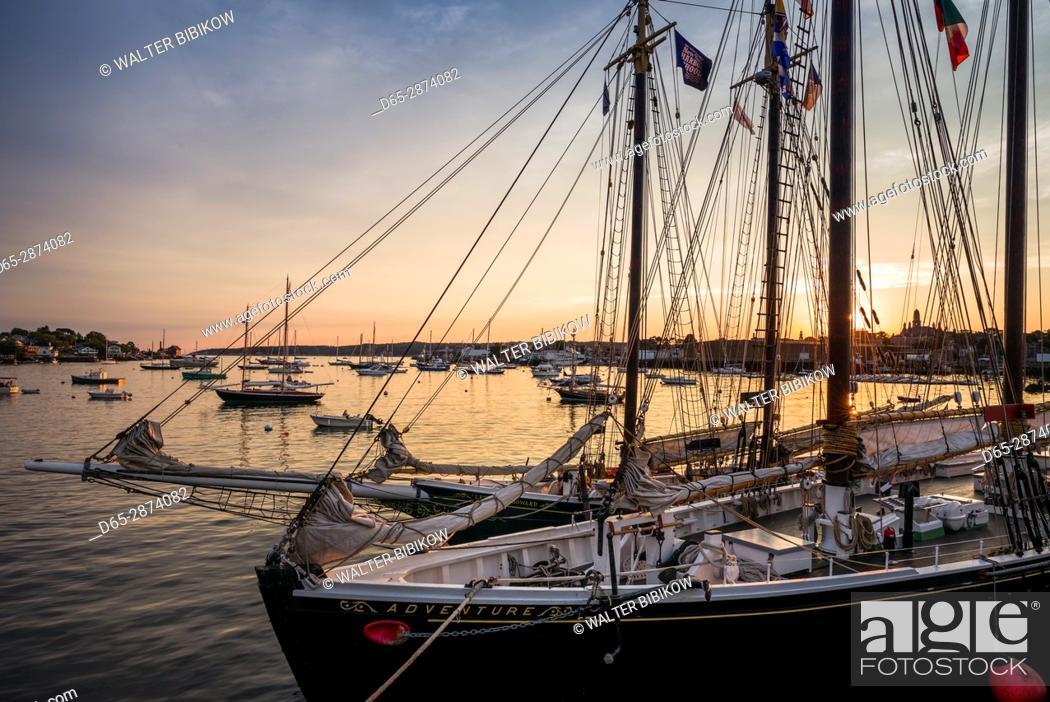 Stock Photo: USA, Massachusetts, Cape Ann, Gloucester, America's Oldest Seaport, Gloucester Schooner Festival, schooners, dusk.