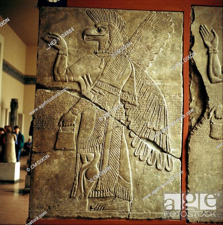 Assyrian relief of winged genie carrying a cedar cone. in the
