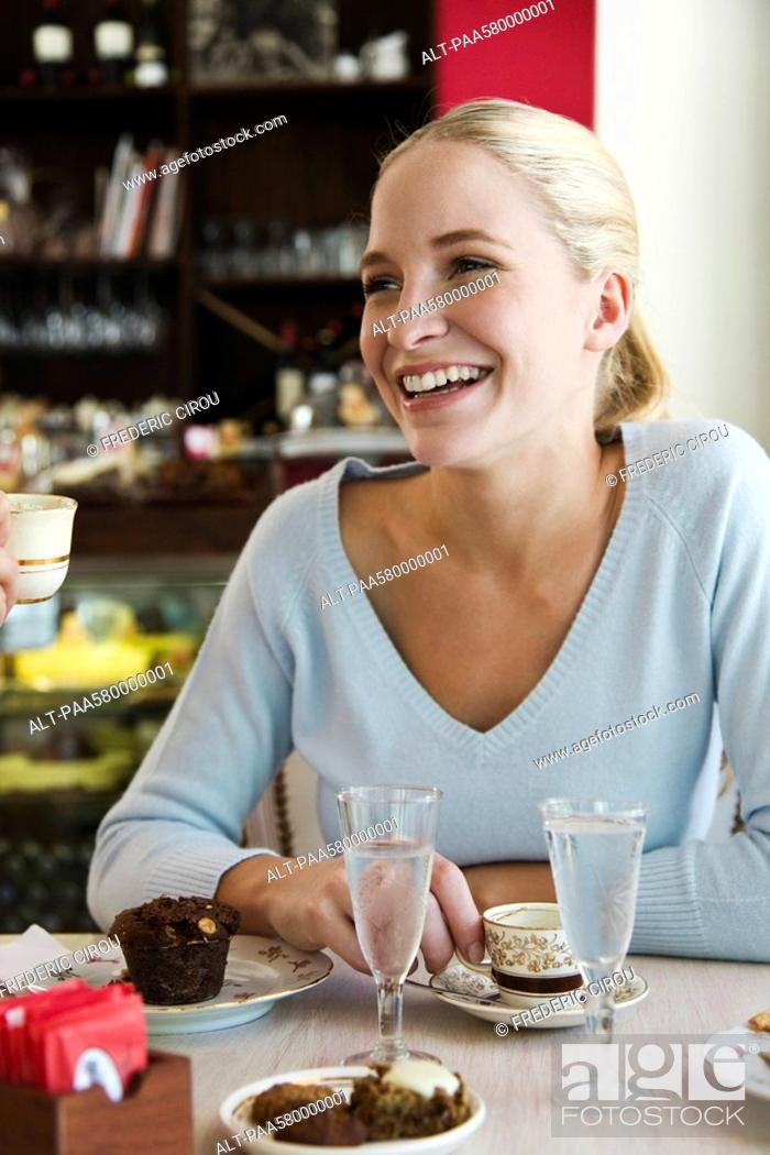 Stock Photo: Young woman at cafe.