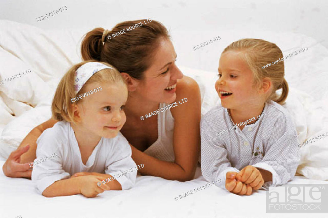 Stock Photo: Mother and daughters.