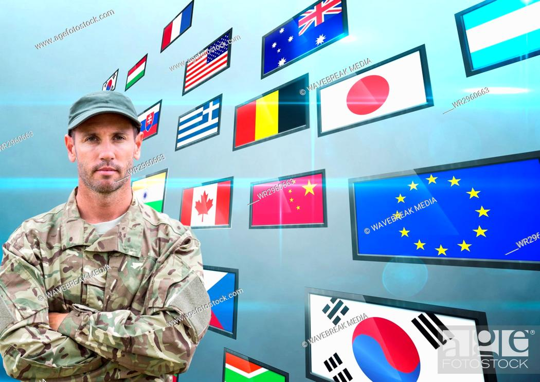 Stock Photo: panel with flags, blue back. Soldier hand folded.