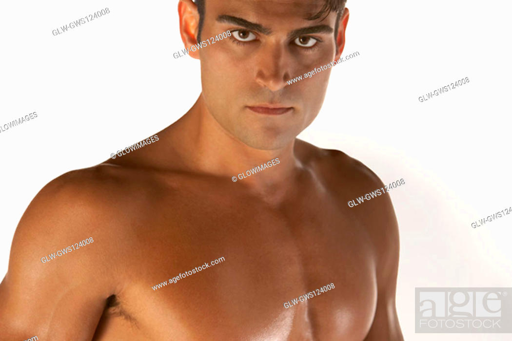 Stock Photo: Portrait of a bare chested young man looking serious.