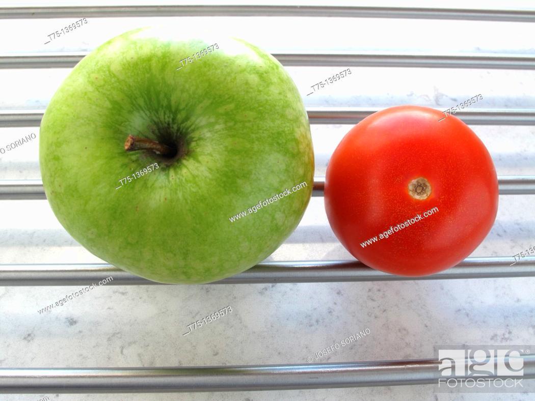 Stock Photo: Granny Smith and tomato.