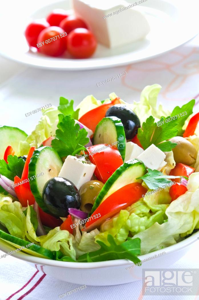 Stock Photo: Greek salad with feta cheese and black and green olives.
