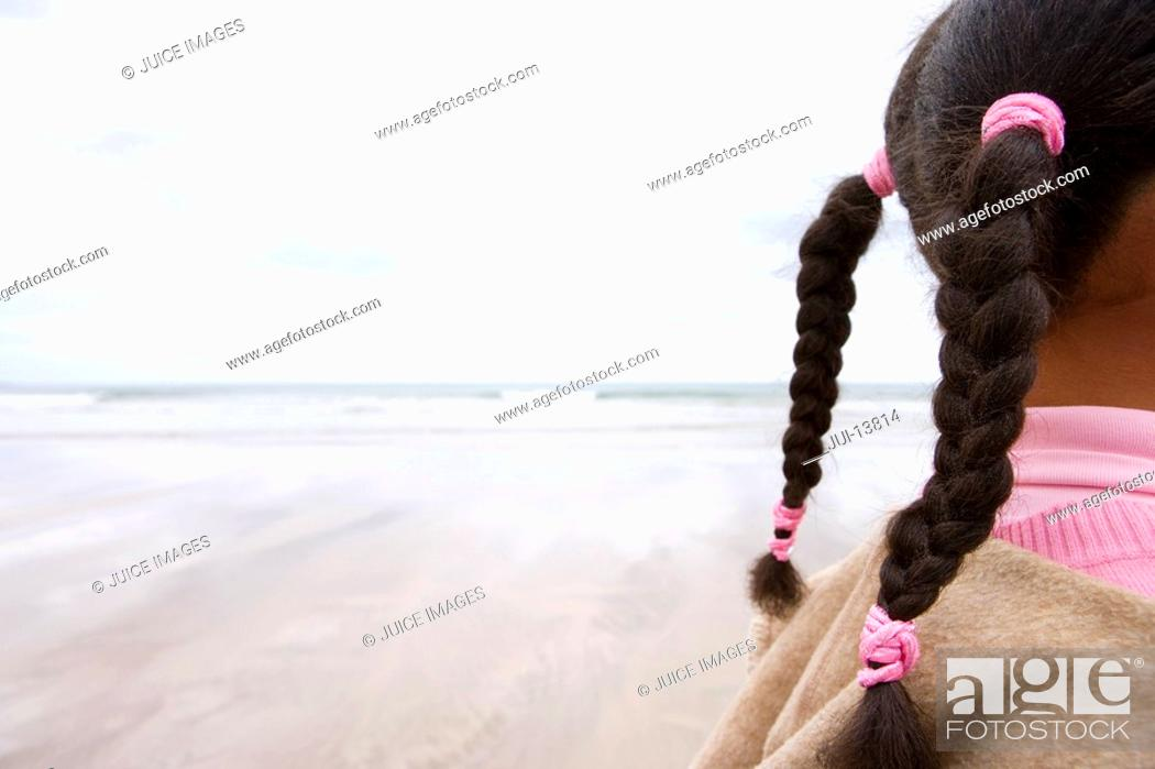 Stock Photo: Girl 7-9 on beach, side view section.