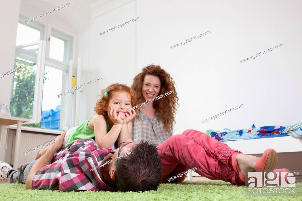 Stock Photo: Germany, Berlin, Family having fun at home.