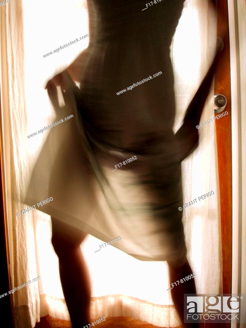 Stock Photo: sexy see through dress with backlight.
