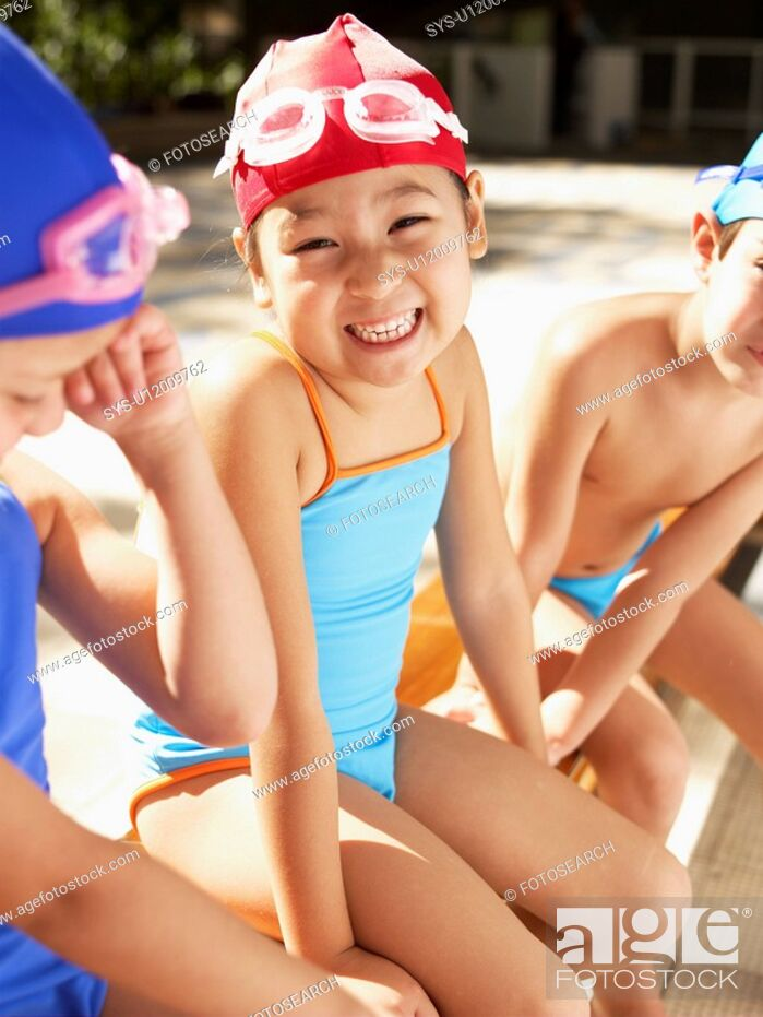 Stock Photo: Girl in swimming costumes sitting on bench portrait.
