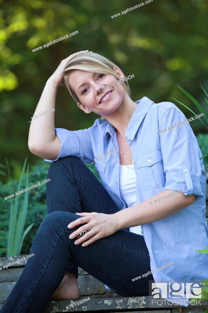 Stock Photo: woman sitting outdoors portrait.