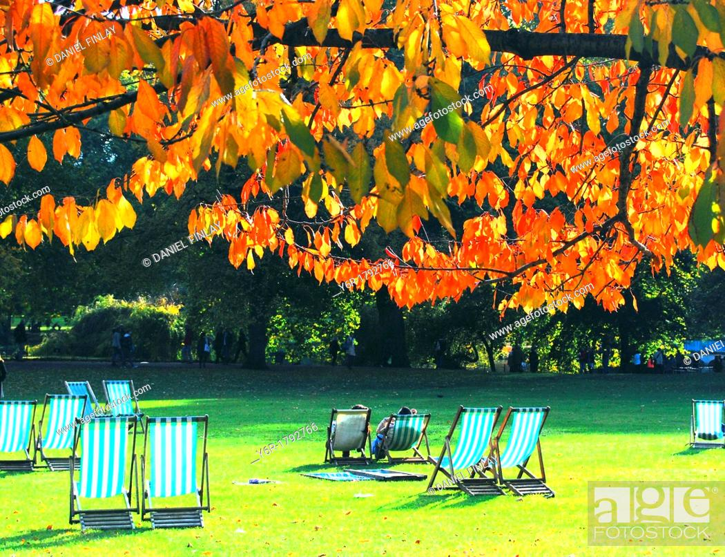 Stock Photo: Visitors enjoy a sunny Autumn/ Fall day in St  James's Park, London, England.