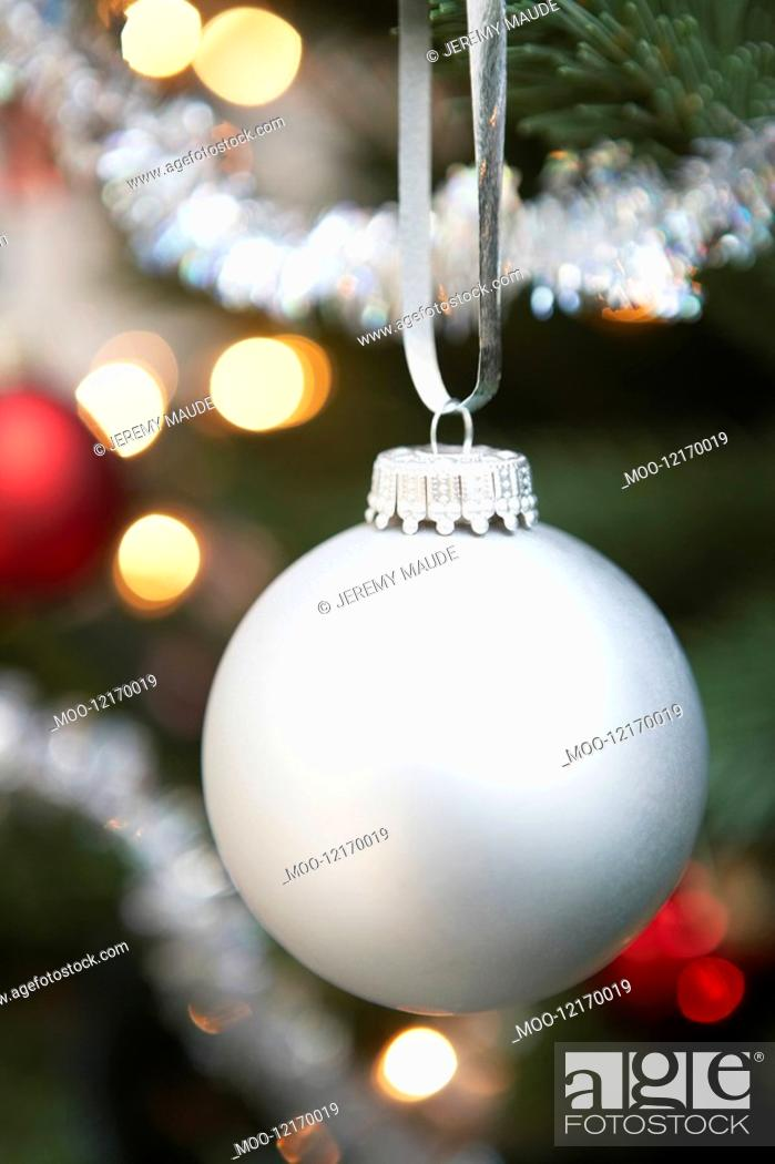 Stock Photo: Silver bauble hanging from christmas tree close up.