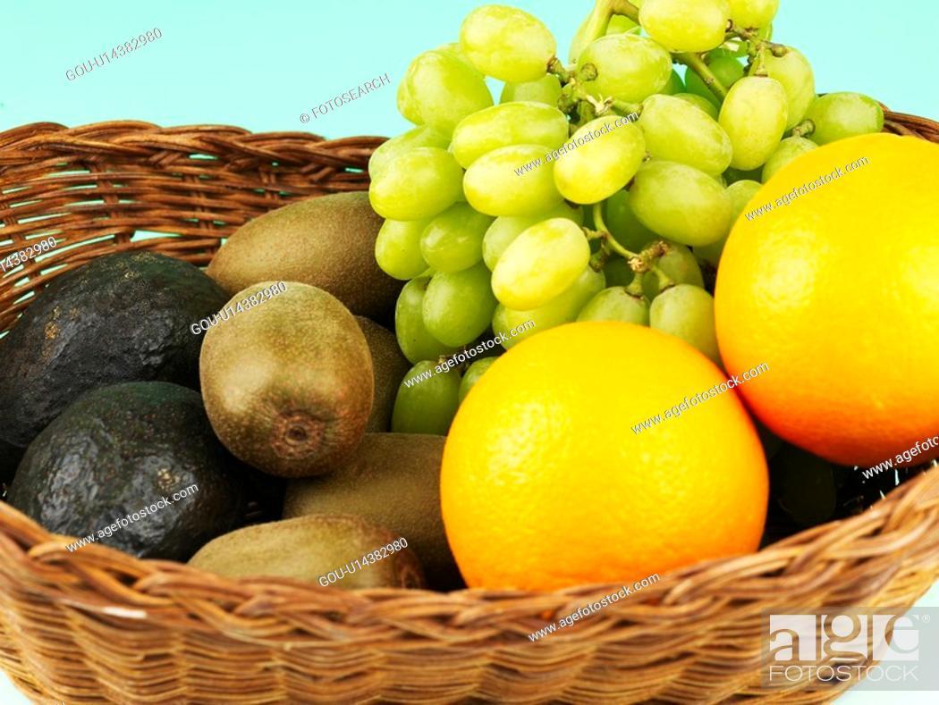 Stock Photo: vegetable, green grape, avocado, orange, kiwi, basket.