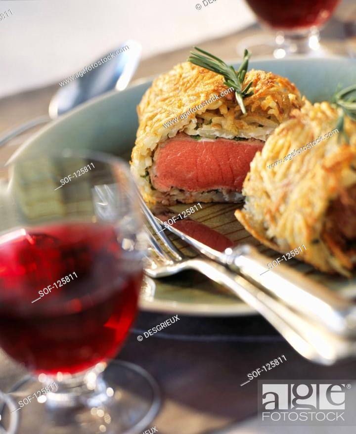Stock Photo: lamb in pastry crust with potatoes.