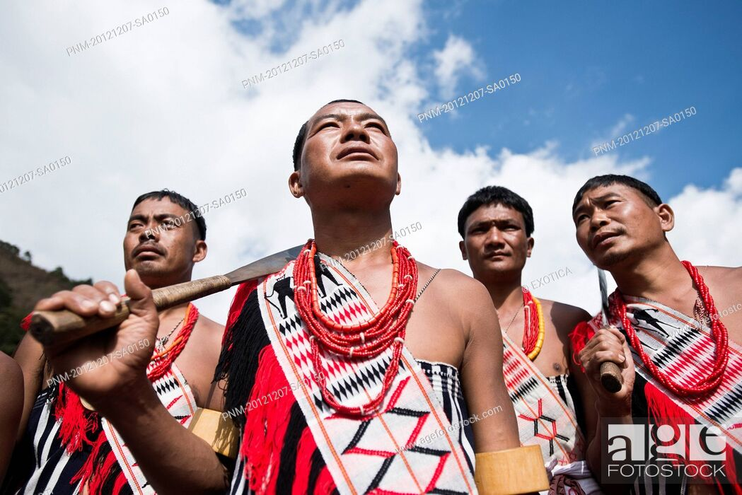Stock Photo: Naga tribesmen in traditional outfit during the annual Hornbill Festival at Kisama, Kohima, Nagaland, India.