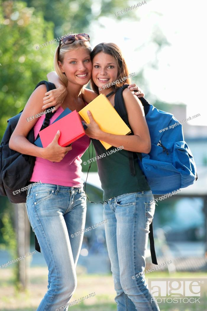 Stock Photo: Happy female friends ready for school.