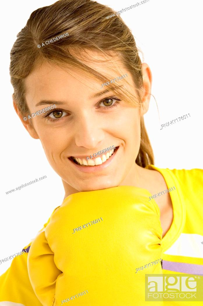 Stock Photo: Portrait of a female boxer wearing a boxing glove and smiling.