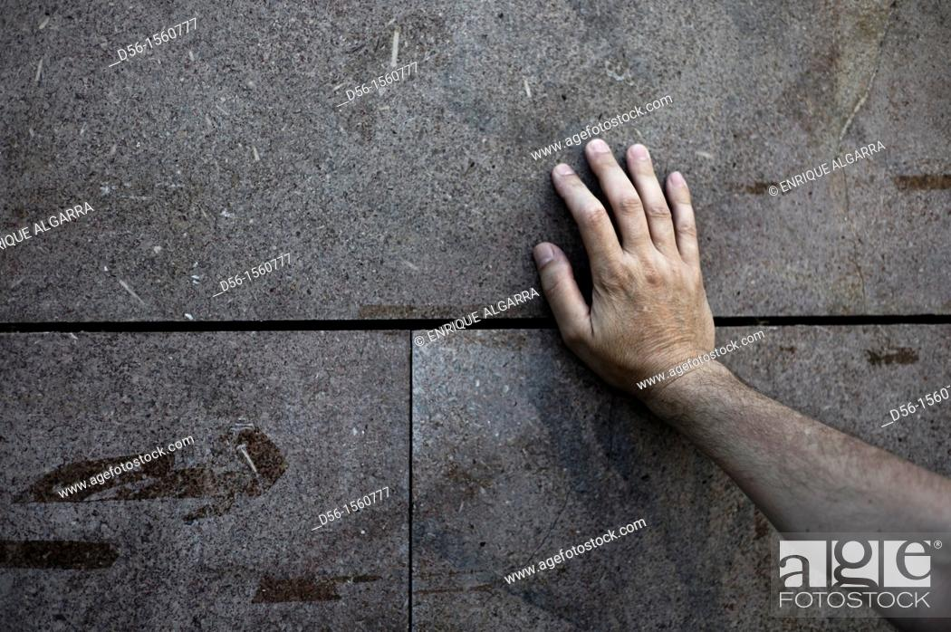 Stock Photo: Hand on a wall.