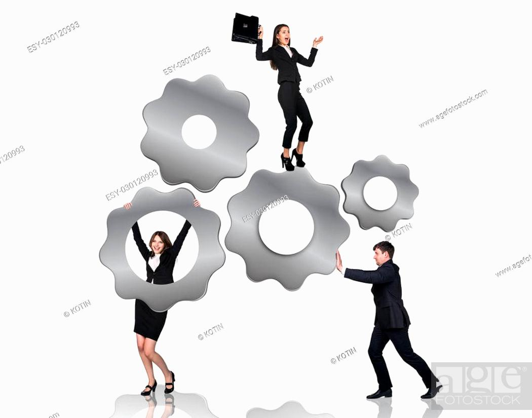 Stock Photo: Businessman pushes metal gears , woman hangs on them, isolated on the white background.