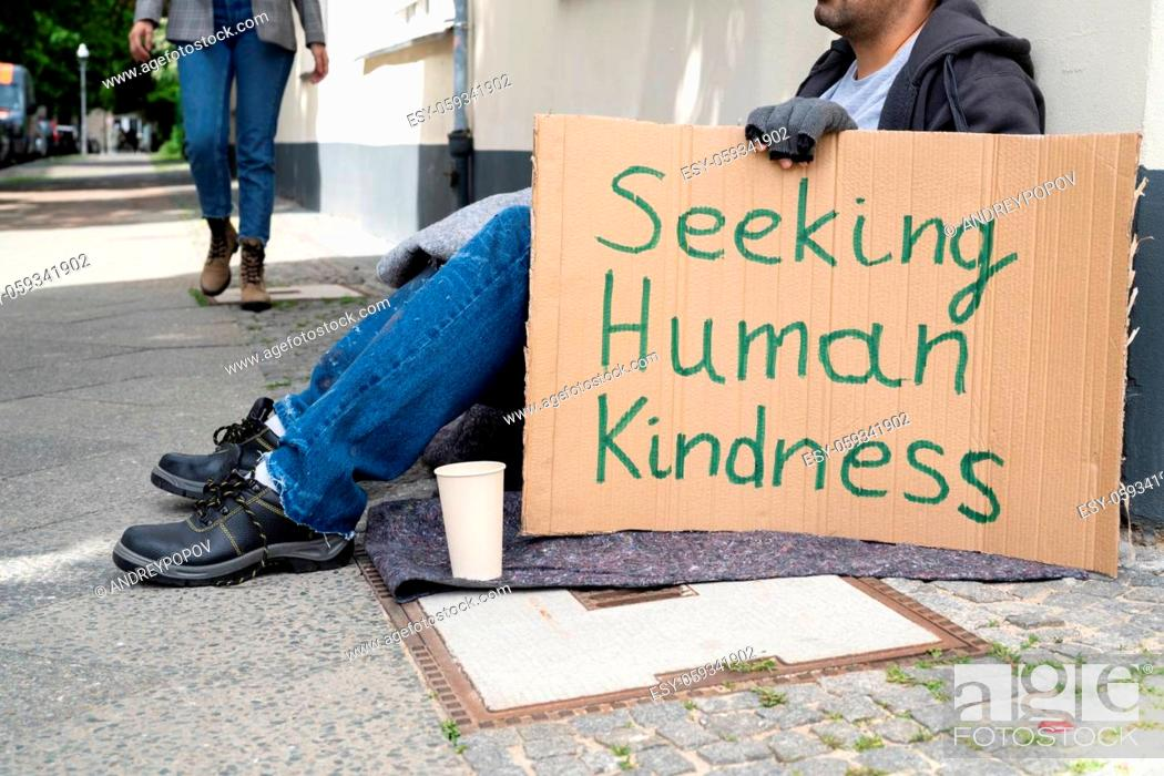 Stock Photo: Homeless Lonely Poor Man With Cardboard Seeking Kindness.