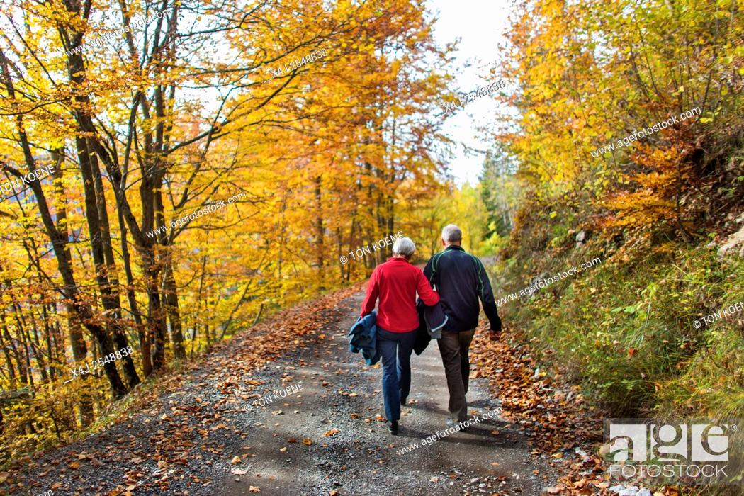Stock Photo: Couple walking during autumn in the French Alps.