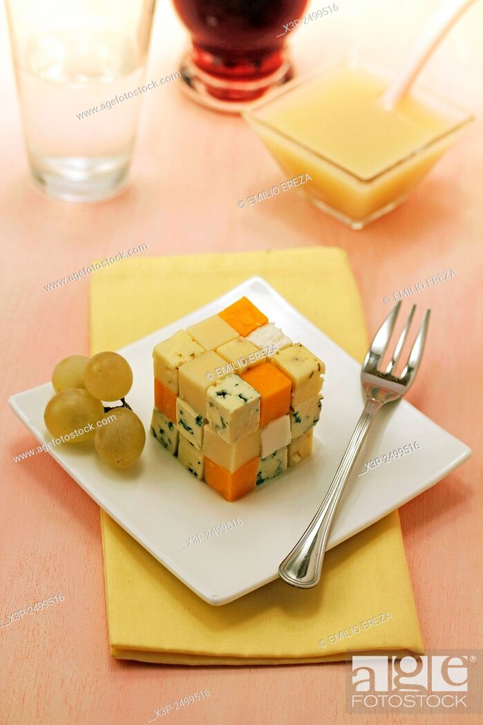 Stock Photo: Cheese cube with grape coulis.