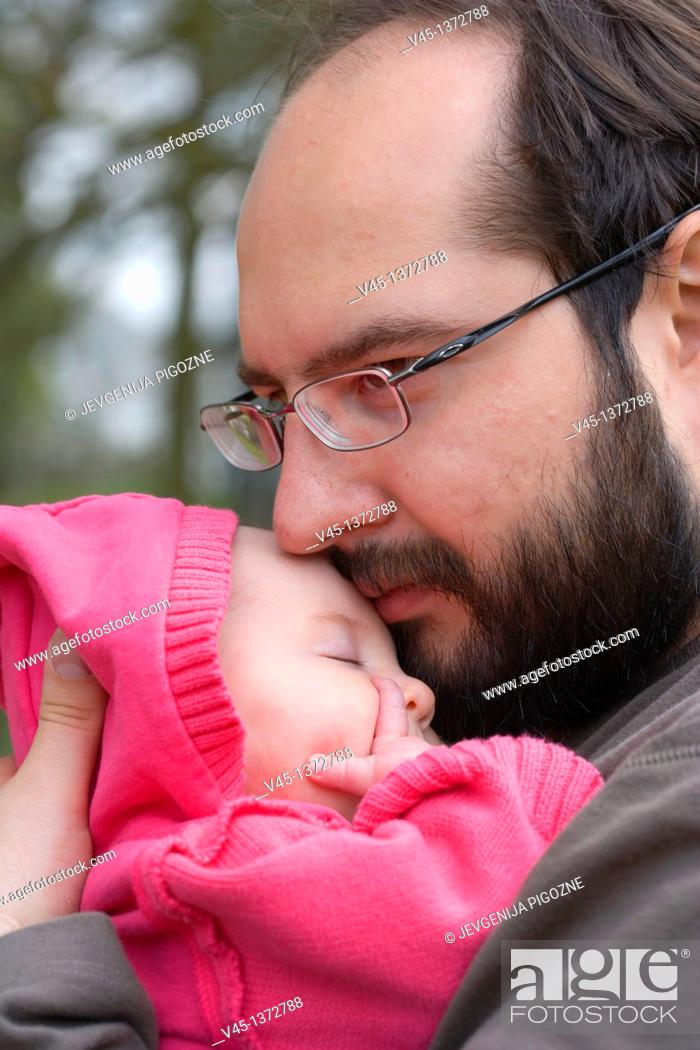 Stock Photo: Father holding baby daughter.