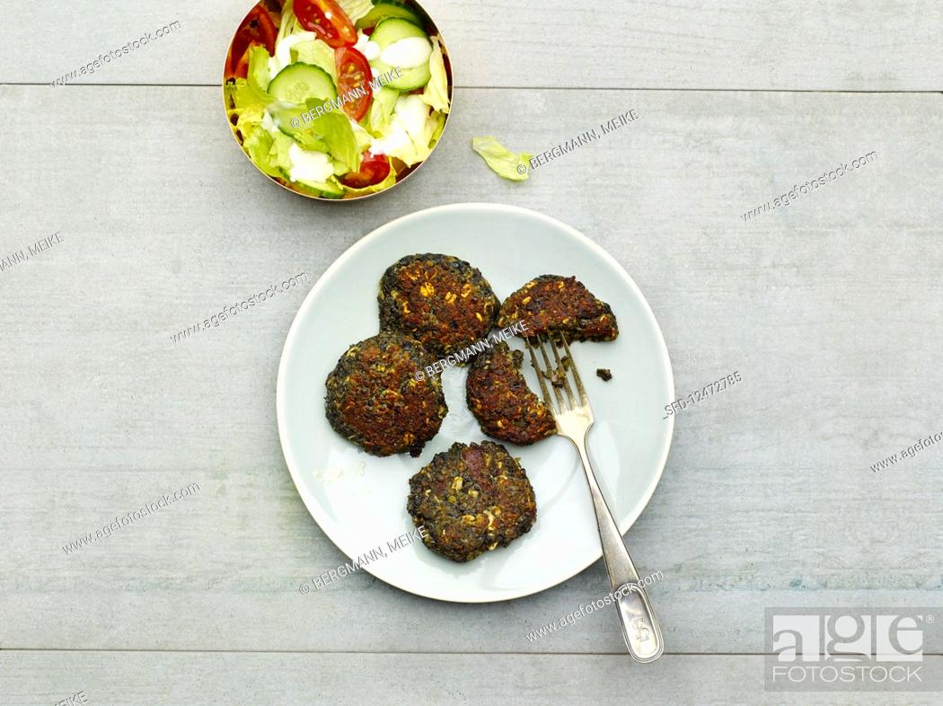 Stock Photo: Lentil fritters served with a summer salad.