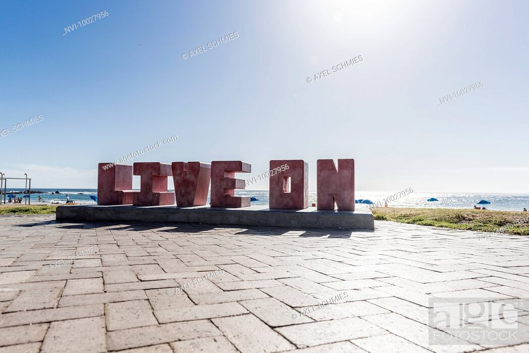 Stock Photo: Lettering LIVE ON on the beach promenade, Camps Bay, Cape Town, Western Cape, South Africa, Africa.