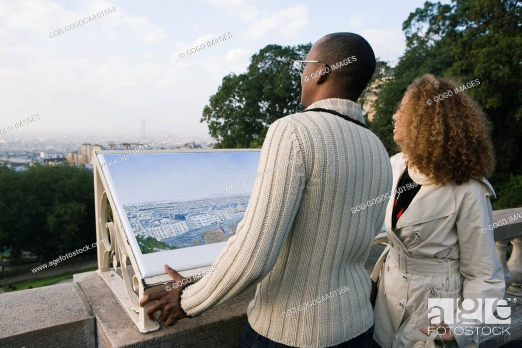 Stock Photo: African couple pointing.