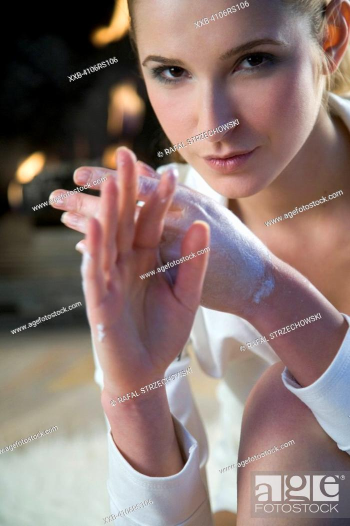 Stock Photo: woman creaming hands.