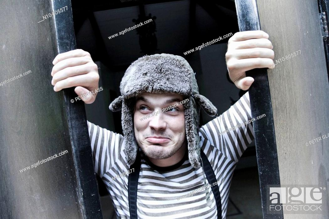Stock Photo: Close-up of a young man wearing a hat and suspenders.