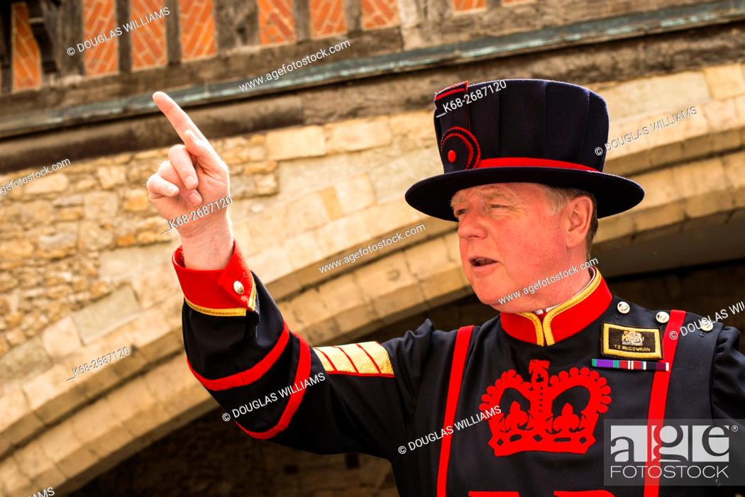Stock Photo: A Beefeater guard gives a talk at the Tower of London, London, UK.