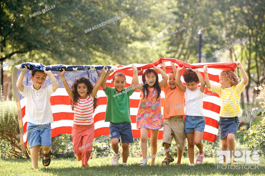 Stock Photo: Children running with American flag.