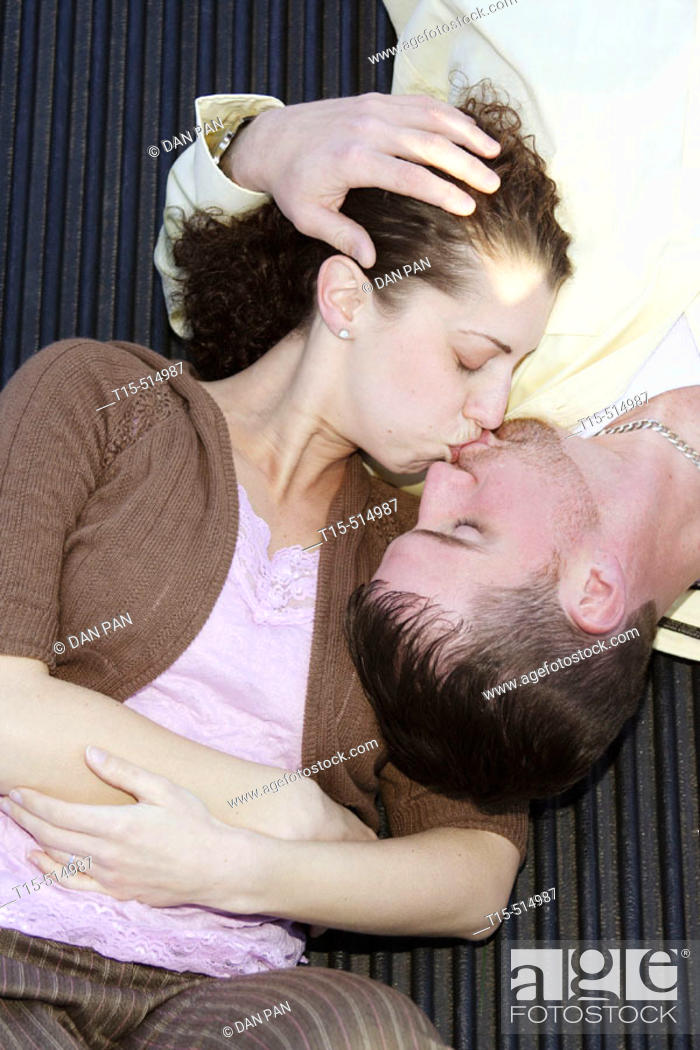 Stock Photo: Couple kissing on the pickup truck bed.