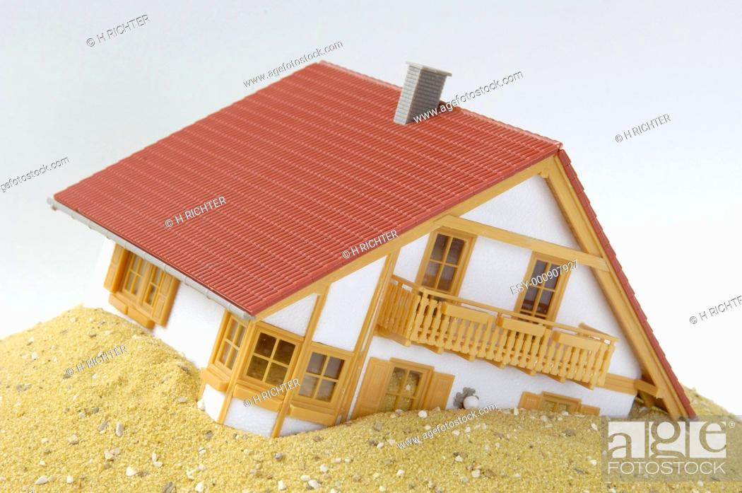 Stock Photo: Model house built on sand.