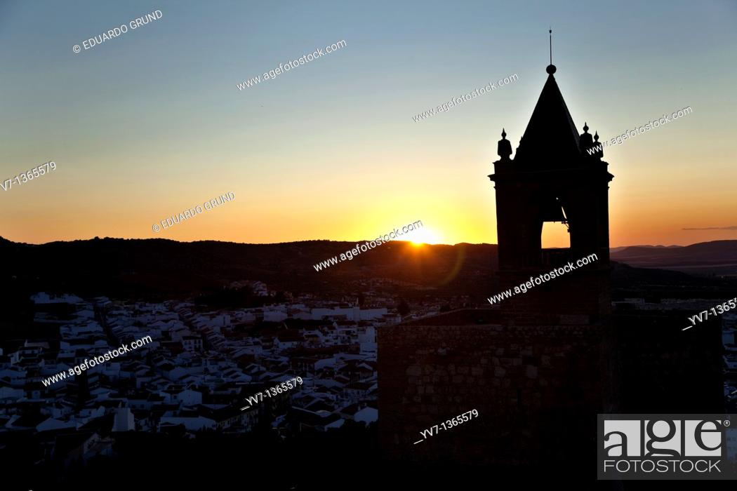 Stock Photo: The sunset, with the Tower of Homage of the Alcazaba to the light, made from the White Tower of the Citadel of Antequera, Antequera, Andalusia, Spain.